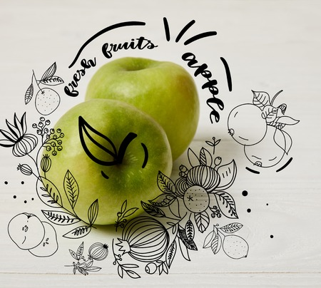 raw green apples on wooden background with floral illustration Fresh fruits - apple lettering