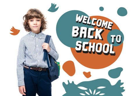 schoolboy holding backpack and looking at camera isolated on white, with welcome back to school lettering