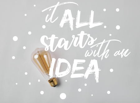 vintage incandescent lamp on white surface with it all starts with an idea inspiration