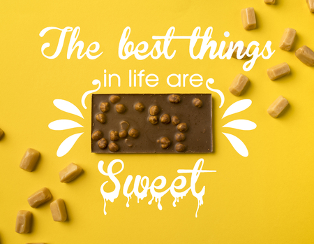 Top view of chocolate bar with scattered iris milk candies isolated on yellow with the best things in life are sweet lettering