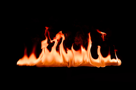 close up view of burning orange fire on black background Imagens