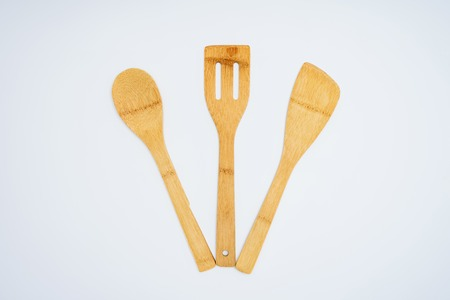 top view of set of wooden kitchen utensils isolated on grey