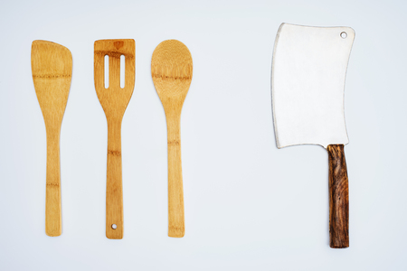 top view of wooden kitchen utensils and meat cleaver isolated on grey Stock Photo