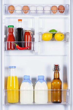 eggs, souses, milk and juice in fridge