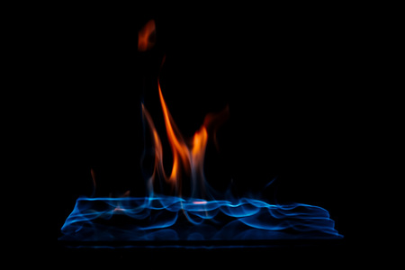 close up view of burning orange and blue flame on black background Foto de archivo - 108827662