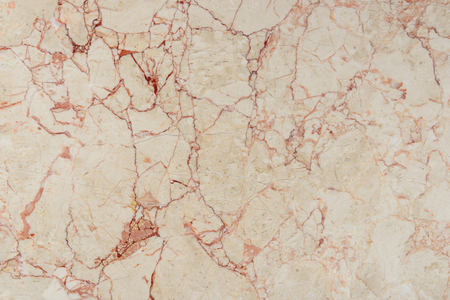 cracked texture of beige marble stone