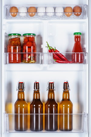 eggs and glass bottles of beer in fridge