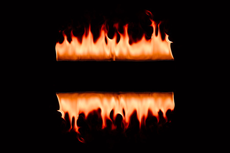 close up view of burning flame lines on black backdrop