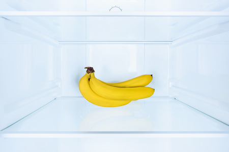ripe tasty bananas on shelf in fridge Stock fotó