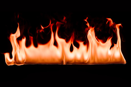 close up view of burning fire on black backdrop Imagens