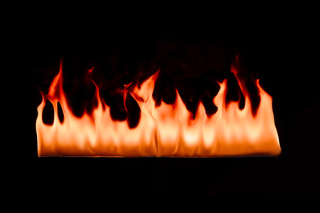 close up view of burning orange fire on black background Stock fotó