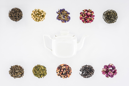 top view of dried herbal organic tea and glass teapot isolated on white Stock Photo