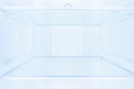 shelves in empty open white fridge