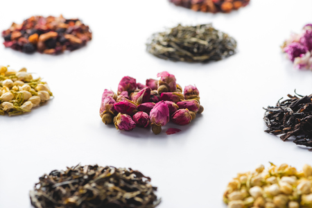 set of dried herbal natural tea on white surface