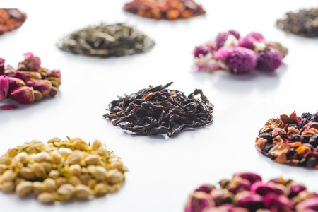 set of dried herbal healthy tea on white surface
