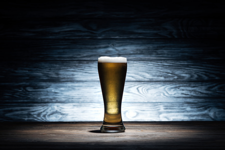 glass of tasty beer with foam on wooden table, oktoberfest concept Stock fotó