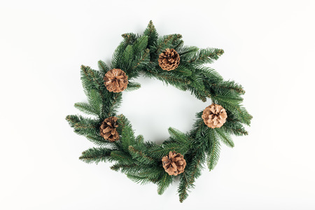 top view of beautiful christmas wreath with pine cones on white background Banco de Imagens