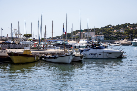 AVIGNON, FRANCE - JUNE 18, 2018: beautiful boats and yachts in calm sea harbour, Avignon, France