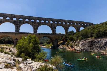 PROVENCE, FRANCE - JUNE 18, 2018: Pont du Gard (bridge across Gard) ancient Roman aqueduct across Gardon River in  Provence, France Standard-Bild - 111375543