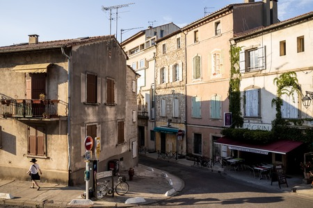 PROVENCE, FRANCE - JUNE 18, 2018: cozy narrow street with outdoor cafe and beautiful old buildings in provence, france
