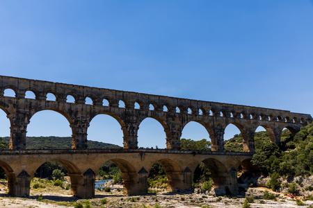 PROVENCE, FRANCE - JUNE 18, 2018: Pont du Gard (bridge across Gard) ancient Roman aqueduct across Gardon River in  Provence, France Sajtókép