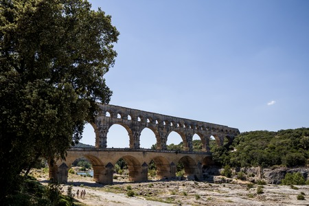 PROVENCE, FRANCE - JUNE 18, 2018: people walking near Pont du Gard (bridge across Gard) in Provence, France Editorial