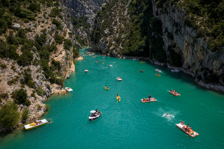 PROVENCE, FRANCE - JUNE 18, 2018: aerial view of people on boats at Gorges Du Verdon Canyon in Provence, France