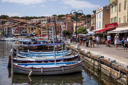 AVIGNON, FRANCE - JUNE 18, 2018: boats in harbour and people walking on embankment, Avignon, france Editorial