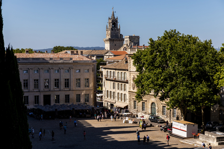 AVIGNON, FRANCE - JUNE 18, 2018: pedestrians on streets and square, beautiful old architecture and scenic cityscape of historical european town Avignon