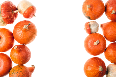 top view of autumnal orange pumpkins isolated on white Фото со стока