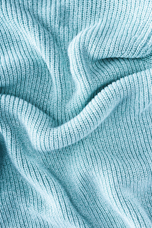 close up view of folded blue woolen cloth as background