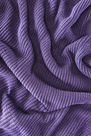 full frame of purple folded woolen fabric as background Banco de Imagens