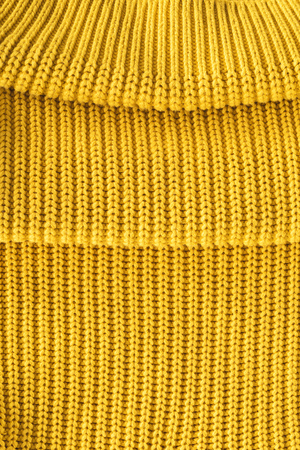 close up view of folded bright yellow woolen fabric as backdrop Banco de Imagens