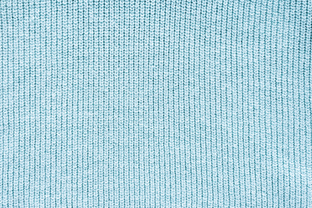 close up view of blue woolen cloth as background