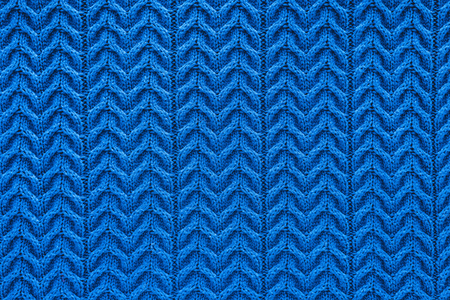full frame of dark blue woolen fabric with pattern as backdrop