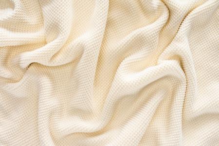 full frame of folded white woolen fabric background Banco de Imagens