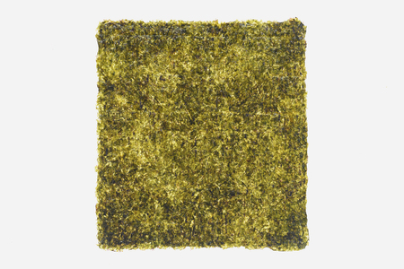 top view of green dried nori sheet isolated on white background