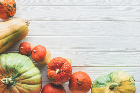 elevated view of autumnal different ripe pumpkins on tabletop Banco de Imagens