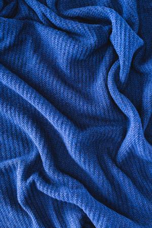 full frame of blue folded woolen fabric as background Banco de Imagens