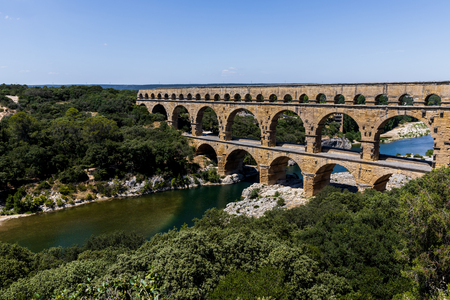 aerial view of Pont du Gard (bridge across Gard) ancient Roman aqueduct across Gardon River in  Provence, France