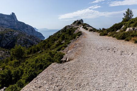 rural road on mountain range, rocky mountains and scenic sea view in Calanques de Marseille (Massif des Calanques), provence, france Stock Photo
