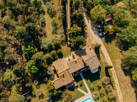 aerial view of villa near forest in Italy