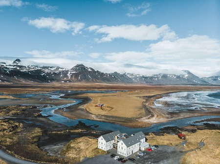 aerial view of houses and cars on beautiful coast, snaefellsnes, iceland