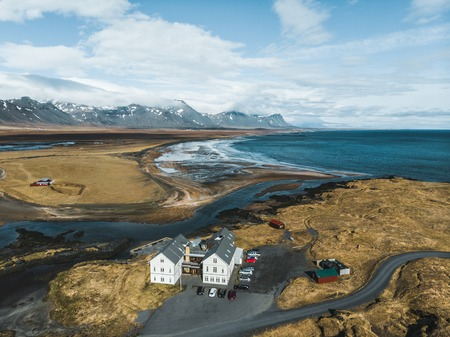 aerial view of houses and cars on seashore, snaefellsnes, iceland