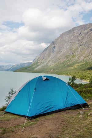 camp tent on Besseggen ridge over Gjende lake in Jotunheimen National Park, Norway Stock Photo