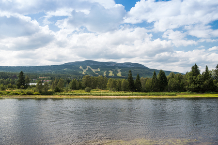 aerial view of river, trees and mountains, Trysil, Norways largest ski resort
