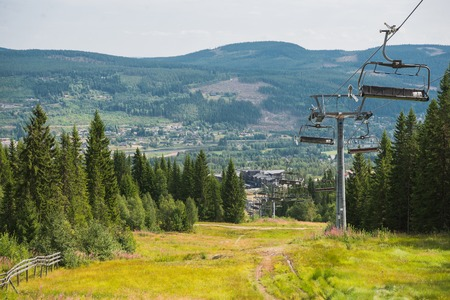 scenic view of ski lift over field and trees in Trysil, Norways largest ski resort Stock Photo