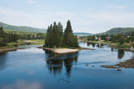 small island with fir trees on river, Trysil, Norways largest ski resort