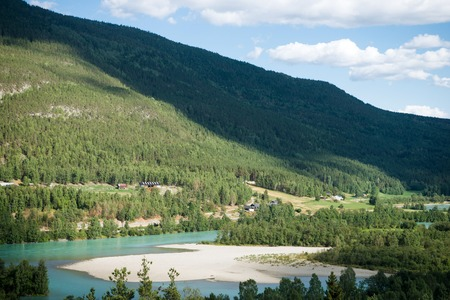 aerial view of lake and trees in front of mountains in Hallingskarvet National park, Norway