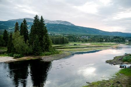 aerial view of river and green mountains on background, Trysil, Norways largest ski resort